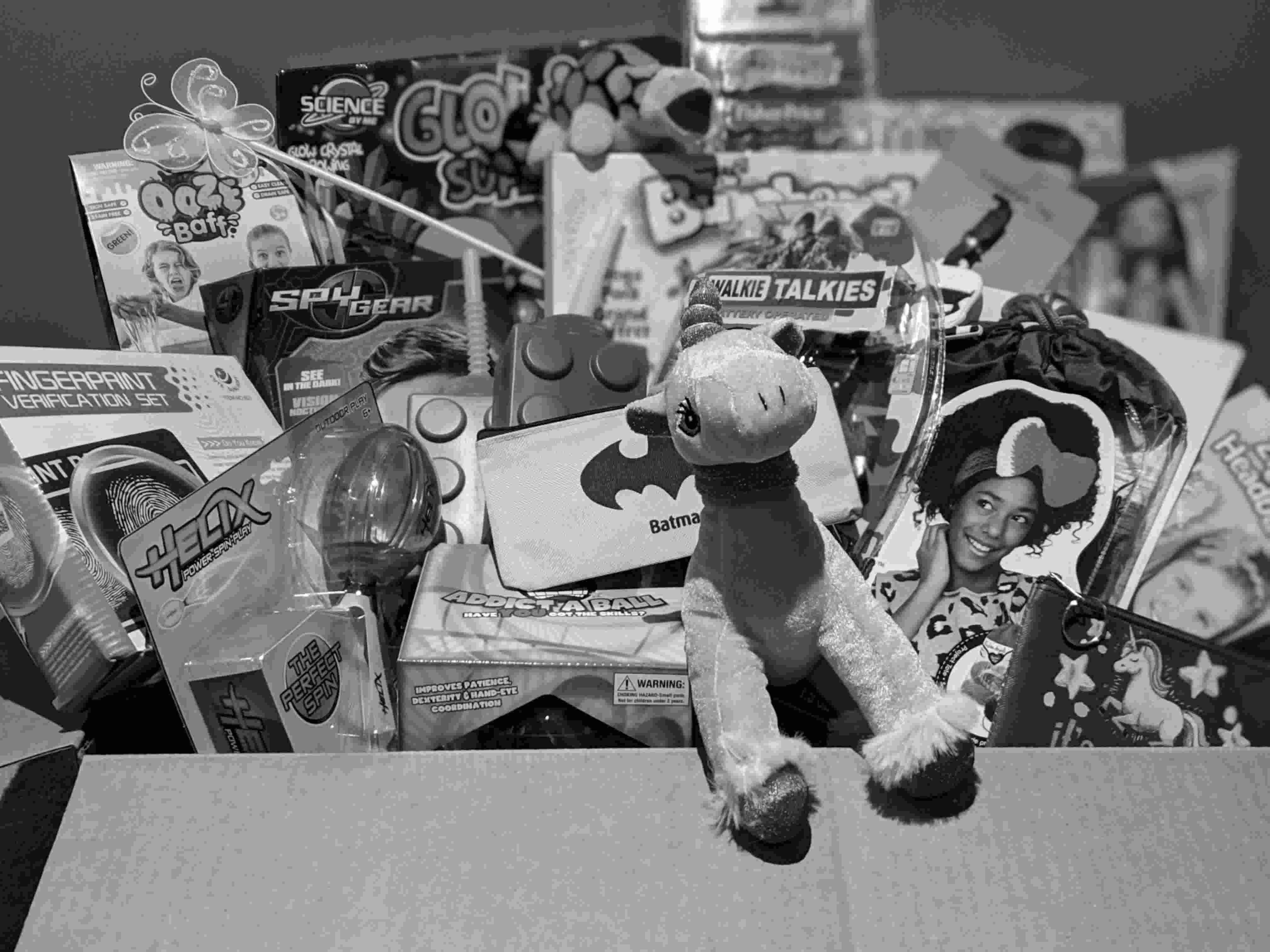 Black and white photo of some of 77boxes products, from a range of categories